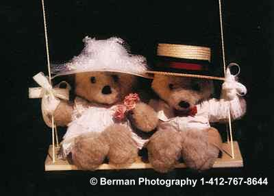 Victorian Teddy Bears enjoying a romantic moment on a swing.