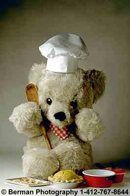 Chef Teddy Bear preparing dessert for all the other teddy bears