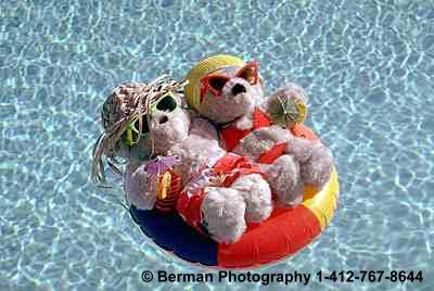 Teddy Bears having a romantic interlude in an innertube.