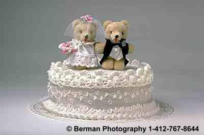 Teddy Bears on a wedding cake.
